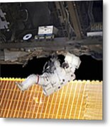 Astronaut Participates In A Spacewalk Metal Print