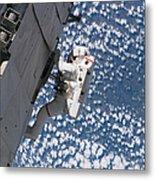 Astronaut Traverses Metal Print