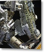 Astronauts Working On The International Metal Print