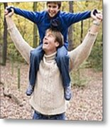 Father Carrying His Son In A Wood Metal Print by Ian Boddy