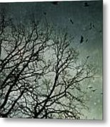Flock Of Birds Flying Over Bare Wintery Trees Metal Print
