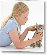 Girl Grooming Kitten Metal Print