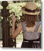 Girl Looking Over Iron Gate Metal Print
