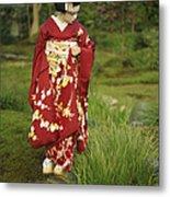 Kimono-clad Geisha In A Park Metal Print by Justin Guariglia