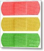 Red Yellow And Green Bandaids Metal Print by Blink Images