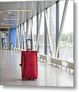 Rolling Luggage In An Airport Concourse Metal Print