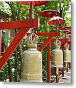 Row Of Bells In A Temple Covered By Red Umbrella Metal Print