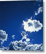 Sunlit Fluffy White Clouds In A Blue Metal Print