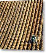 Tractor Plowing A Field Metal Print