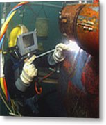 U.s. Navy Diver Welds A Repair Patch Metal Print