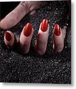 Woman Hand With Red Nails On Black Sand Metal Print