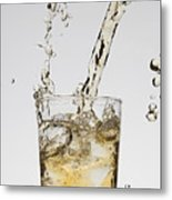 A Drink Being Poured Into A Glass Metal Print