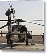 A Uh-60 Black Hawk Helicopter Parked Metal Print