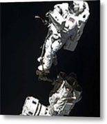 An Astronaut Anchored To A Mobile Foot Metal Print