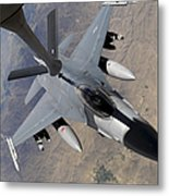 An F-16 Fighting Falcon Receives Fuel Metal Print