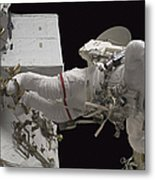 Astronaut Working On The International Metal Print