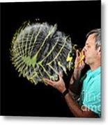 Man Over-inflating Balloon Metal Print
