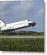 Space Shuttle Discovery Lands On Runway Metal Print
