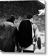 two male walkers hikers in the highlands of scotland glencoe Scotland UK Metal Print