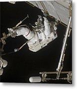Astronaut Working On The International Metal Print