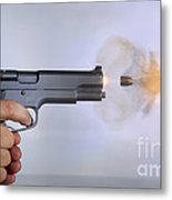 Handgun And .45 Caliber Bullet Metal Print