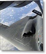 A B-2 Spirit Receives Fuel Metal Print by Stocktrek Images