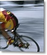 A Bicyclist Speeds Past In A Race Metal Print