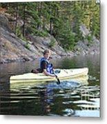 A Boy Kayaking Metal Print