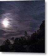 A Bright Moon Rises Through Clouds Metal Print