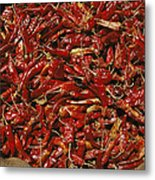 A Burlap Bag Full Of Red Hot Peppers Metal Print by James P. Blair