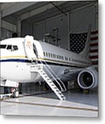 A C-40 Clipper In A Hangar Metal Print