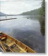 A Canoe Floats Next To A Dock Metal Print