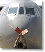 A Crew Chief Marshals In A C-141b Metal Print