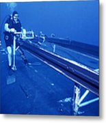 A Crewman Cranks Out The Dry Deck Metal Print by Michael Wood