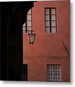A Dark Alley Way Leads To A Lit Brick Metal Print