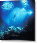 A Diver Hovers Inside The Archway As Metal Print
