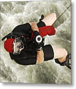 A Diver Is Hoisted Aboard An Sh-60f Metal Print