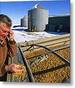 A Farmer Runs His Corn Through His Hand Metal Print by Joel Sartore