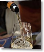 A Glass Of White Wine Being Poured Metal Print