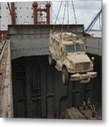 A Harbor Crane Lifts A Mine-resistant Metal Print