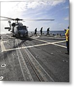 A Helicpter Sits On The Flight Deck Metal Print