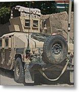A Humvee Patrols The Streets Of Kunduz Metal Print