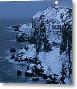 A Lighthouse Atop Snow-covered Cliffs Metal Print