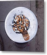 A Lot Of Cigarettes Stubbed Out At A Garbage Bin Metal Print