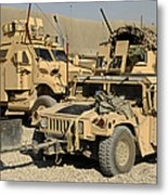 A M1114 Humvee Sits Parked In Front Metal Print