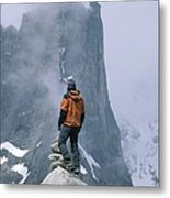 A Man Stands On A Cliff Watching Metal Print