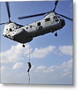 A Marine Fast Ropes From A Ch-46e Sea Metal Print