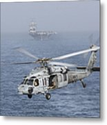 A Mh-60s Knighthawk Conducts A Vertical Metal Print by Gert Kromhout