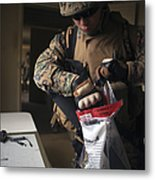 A Military Policeman Collects Materials Metal Print