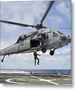 A Naval Aircrewman Is Hoisted Into An Metal Print